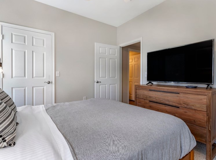 Model Bedroom with Contemporary Furniture and TV on Dresser