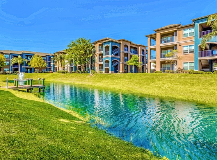 pond with apartment buildings in the background