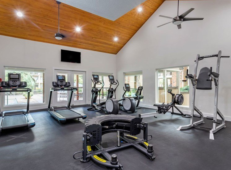 Fitness center with treadmills and lifting stations