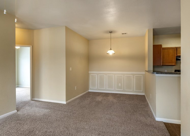 Dining room with carpet flooring and eggshell white painted walls