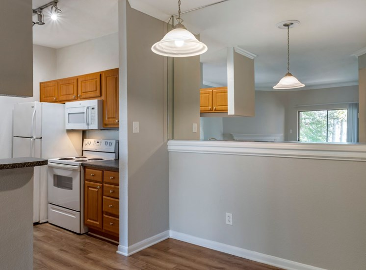 Gray walls, attached to the kitchen, dining room area, and hardwood style flooring.