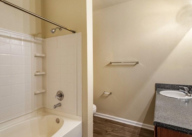 Bathroom with garden style tub and a towel rack
