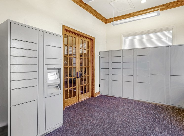 Package lockers of varying sizes inside an interior area.