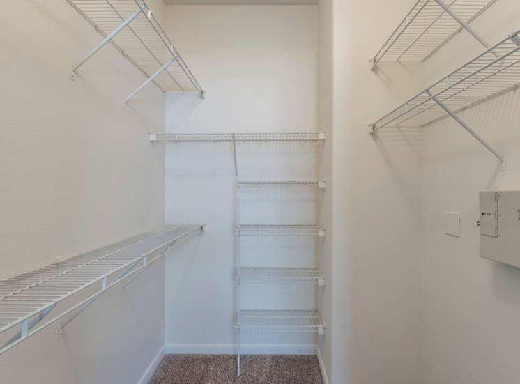 Walk in closet with built in storage units