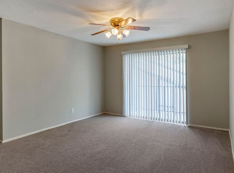Living room with ceiling fan and balcony door with blinds