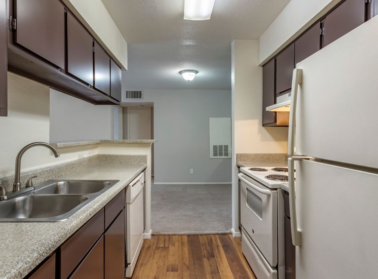 Fully equipped kitchen with espresso cabinets and hardwood style floors
