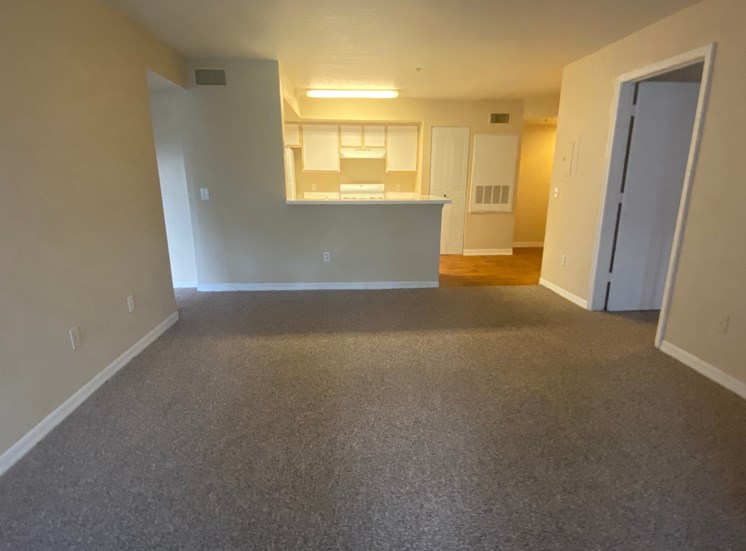 Carpeted Living Room with kitchen/dining room view, dual tone paint