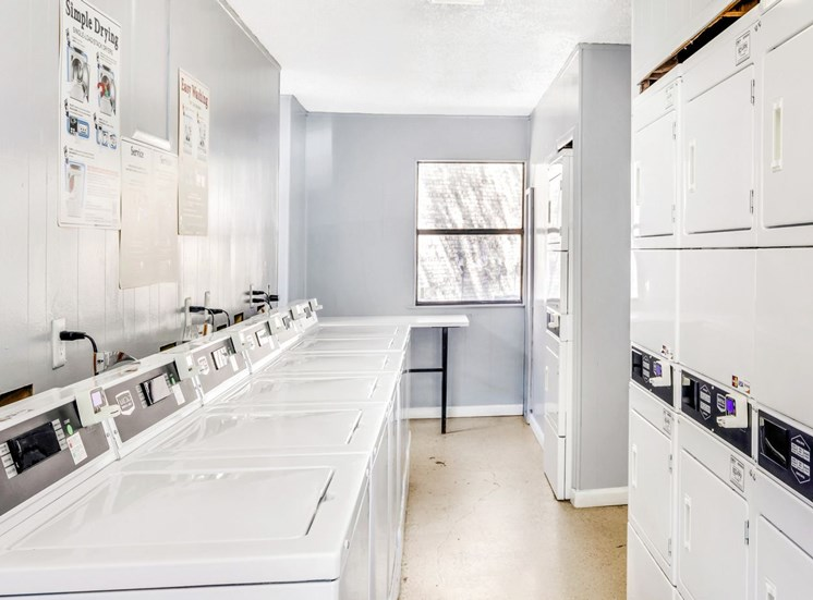 Laundry facility with a shelf and a laundry folding station table