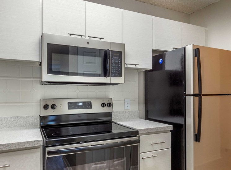 Kitchen with White Cabinets Grey Counters and Stainless Steel Appliances