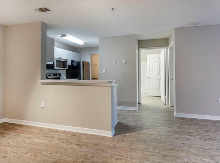 Open Floor Plan with Breakfast Bar off Kitchen and Hardwood Style Flooring
