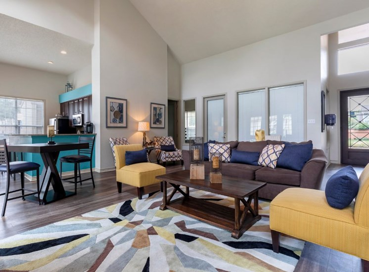 Clubhouse interior with teal accent walls mustard yellow accent chair and hardwood style flooring