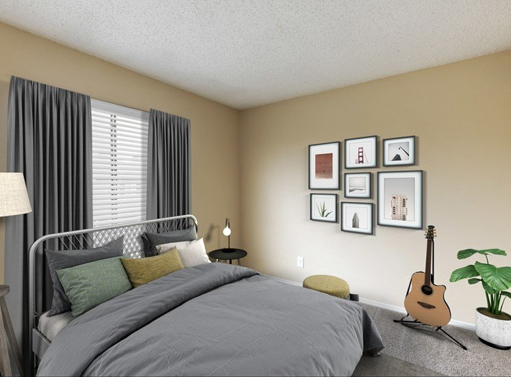bedroom with frames on walls, a guitar, and gray curtains hanging on the wall