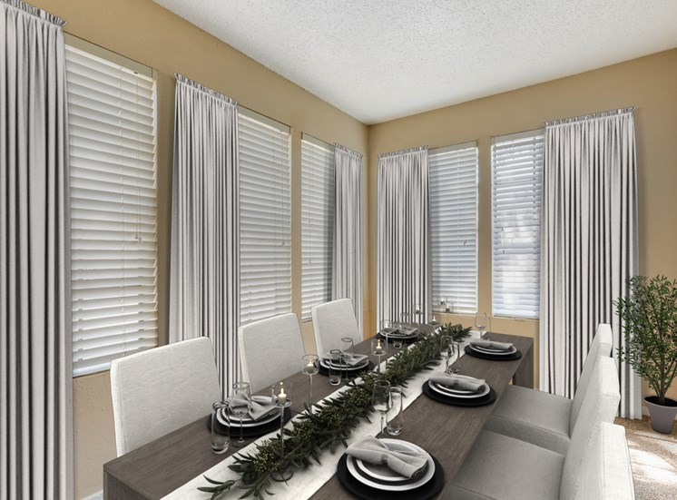 Dining room with large kitchen table with six chairs and placements around the perimeter
