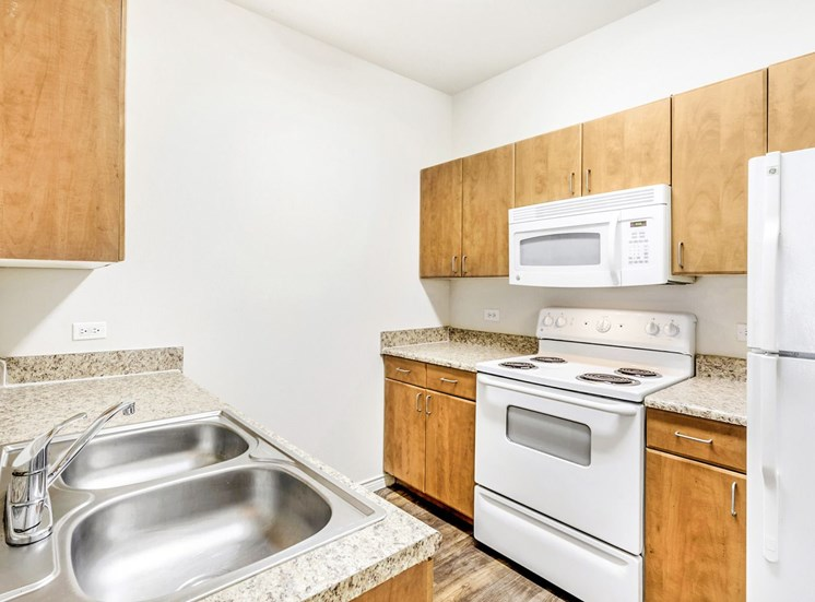 Kitchen with Double Basin Sink white appliances