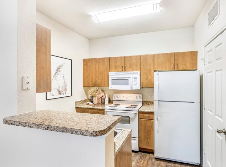 Kitchen with  whit appliances and microwave