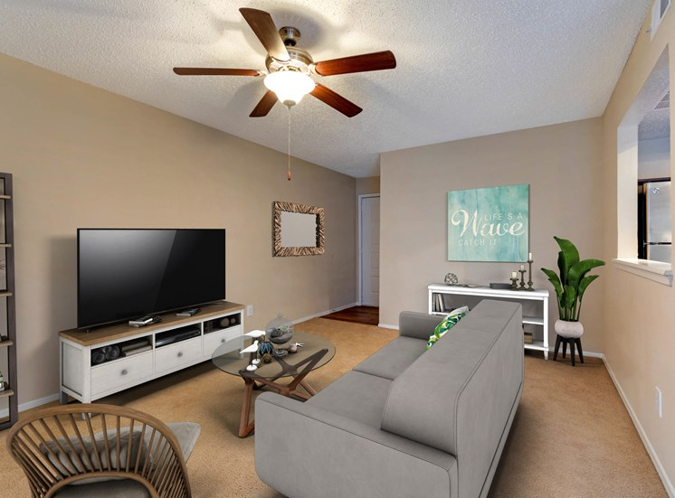 Furnished Living Room with a sofa, ceiling fan, and coffee table