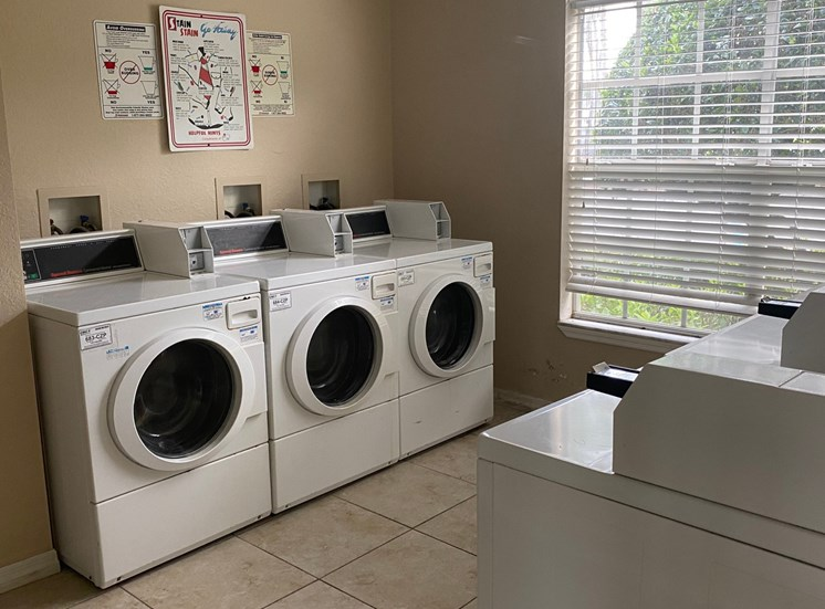Laundry center with washer and dryers and tile flooring