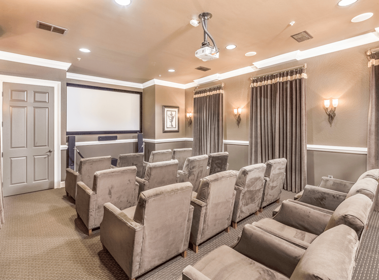 Clubhouse movie theater with chairs and carpet flooring
