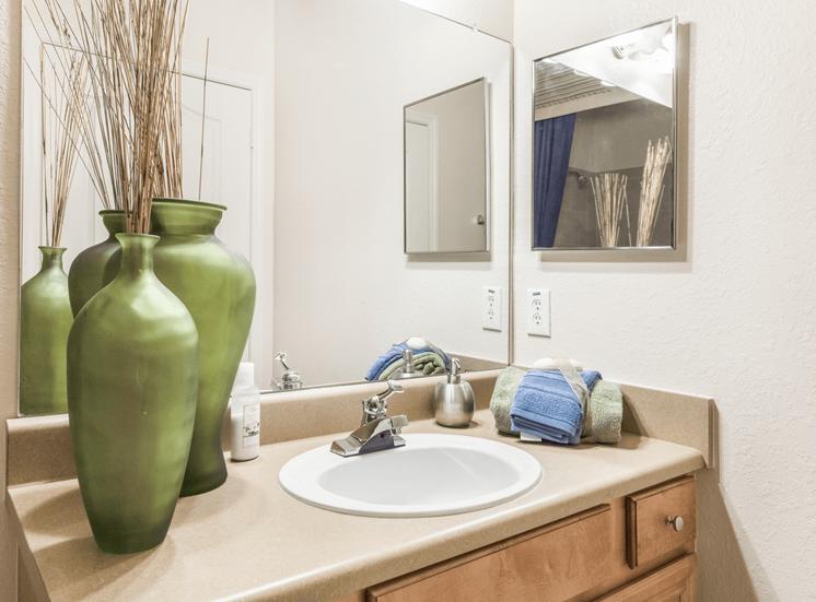 Bathroom sink with mirror, medicine cabinet, and vanity lighting