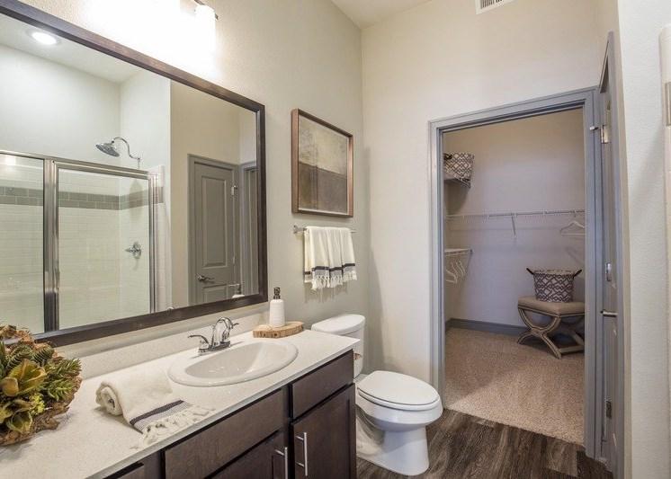 Bathroom with hardwood style flooring, white countertops