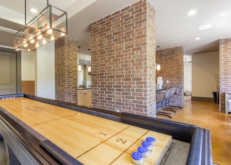 Billiards and game room with hardwood style flooring and a brick column