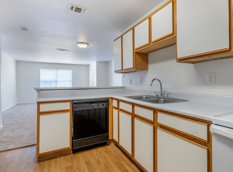 Kitchen with appliances and white countertops.