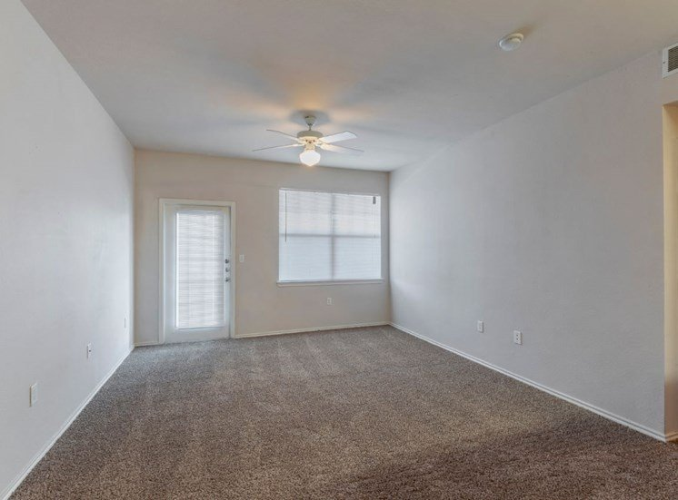 Living Room with Ceiling Fan, wall to wall carpet, and windows with blinds