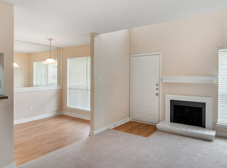 Living room and view of dining room with fireplace