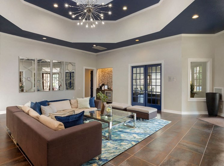 Clubhouse Seating Area with Sectional Couch on Area Rug with Coffee Table