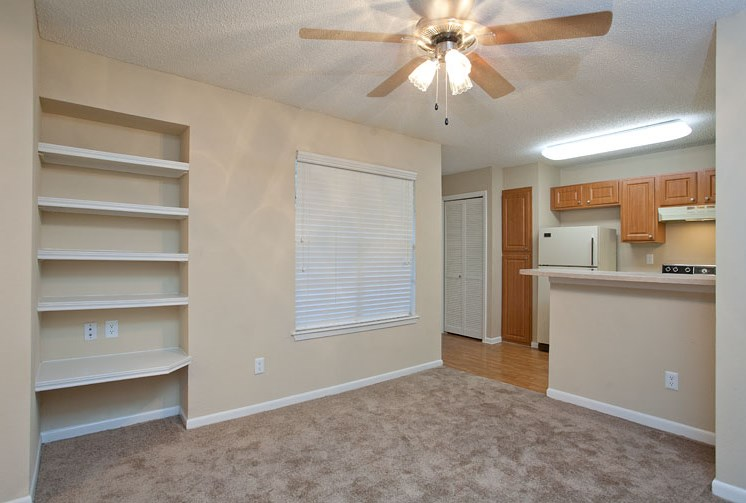 Open Layout Floor Plan with Built in Shelves and Breakfast Bar