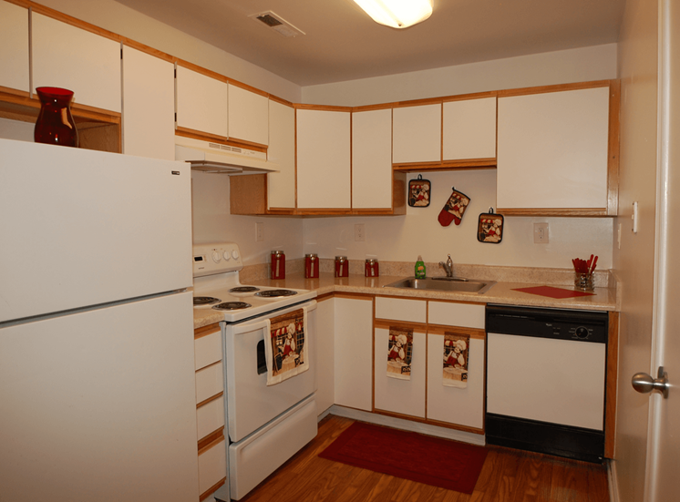 Model Kitchen with White Appliances, White Cabinets at Parkview Apartments, Huntersville, NC