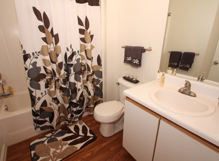 Bathroom with shower curtain and a Towel rack above the commode