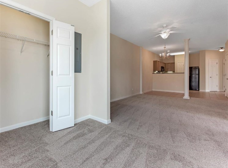 Open Floor Plan View From Carpeted Living Room and Dining Room with Closet Breakfast Bar into Kitchen