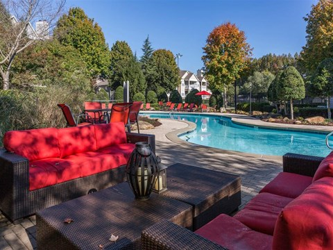 Poolside Lounge Area with Patio Couches with Red Cushions