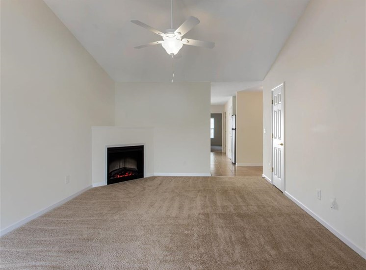 Carpeted Living Room with Fireplace and Ceiling Fan