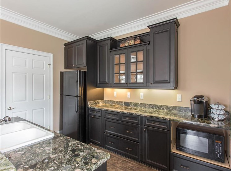 Clubhouse Grey Counters and Black Cabinets