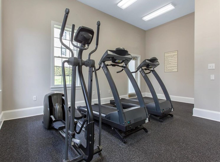 Fitness Center with Exercise Equipment in Front of Windows