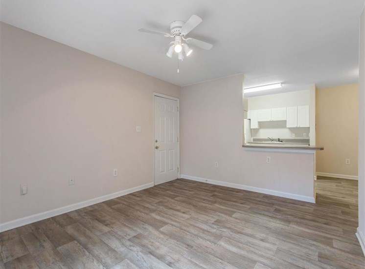 Living Room with Hardwood Style Flooring and Breakfast Bar to Kitchen
