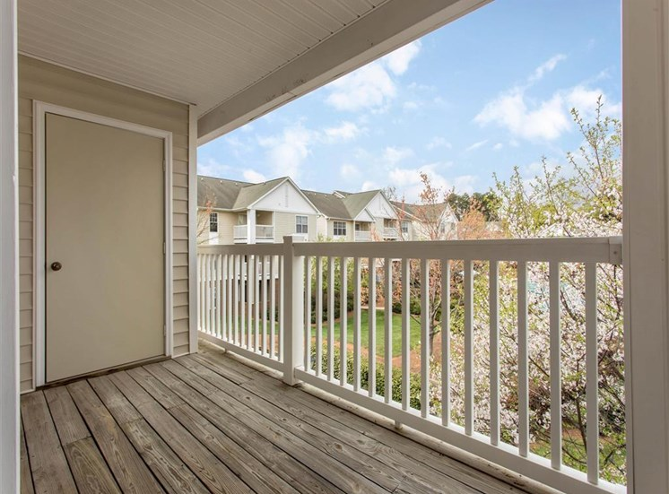 Private Balcony with Wood Flooring and White Railing