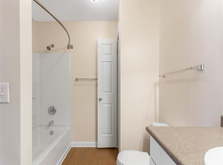 Bathroom with Linen Closet and White Shower with Bathtub