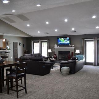 Clubhouse Seating Area With TV And Fireplace at Parkview Apartments, Huntersville