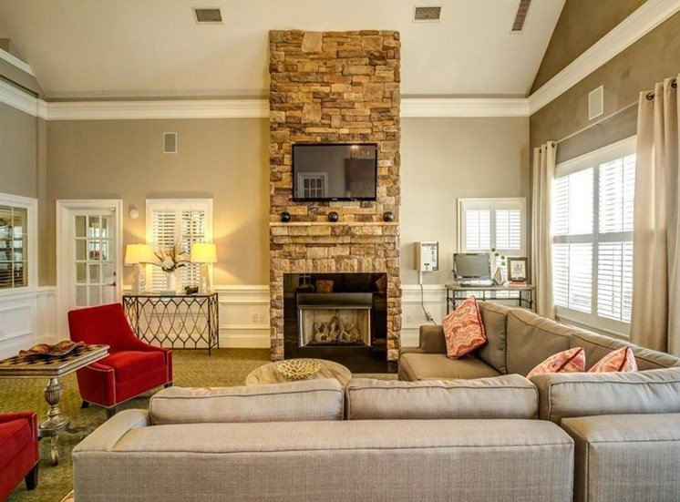 Clubhouse Seating Area Around Stone Fireplace with Mounted TV
