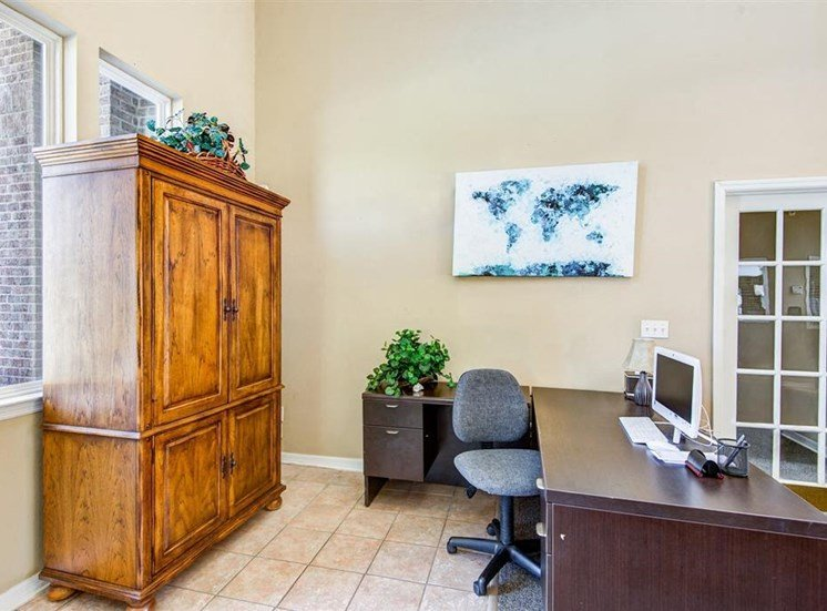 L Shaped Computer Desk with Grey Chair and Wood Armoire