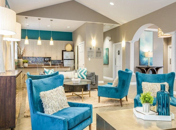 Clubhouse Seating Area with Blue Accents Armchairs and Coffee Tables