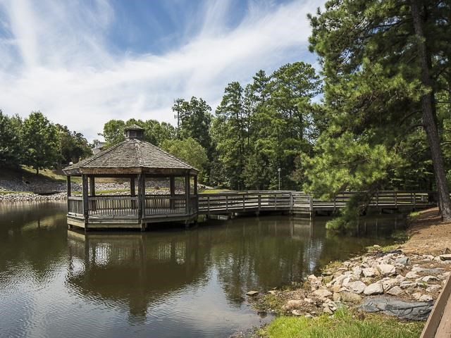 Gazebo on the Water with Trees in the Background