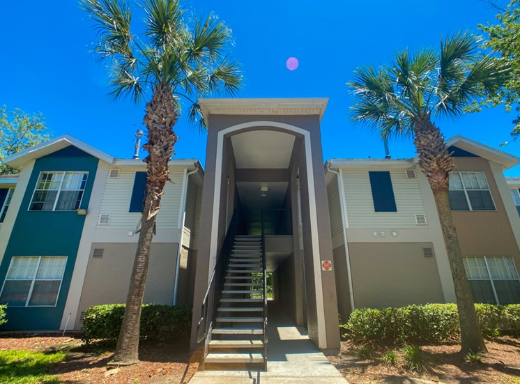 Apartment building exterior with palm trees