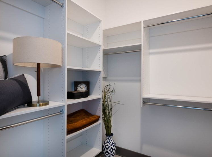 Model Closet with Built in Shelving and Decorative Items on Shelves