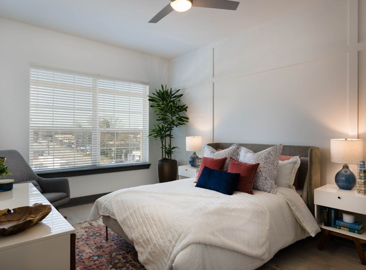 Model Bedroom with Contemporary Furniture and Large Window