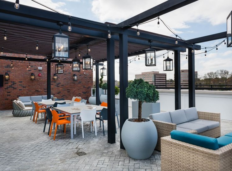 Outdoor Lounge Area with Seating Under Pergola with String Lights