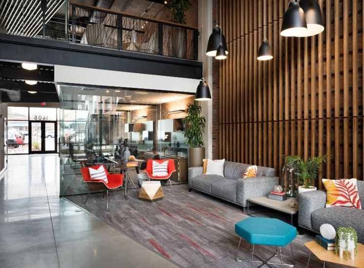 Leasing Office Seating Area with Contemporary Furniture Aligned with Wall with Wooden Slats